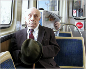 Elderly man  riding the bus