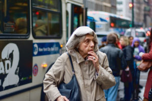 Elderly woman in the city