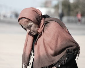 Elderly woman wearing a shawl