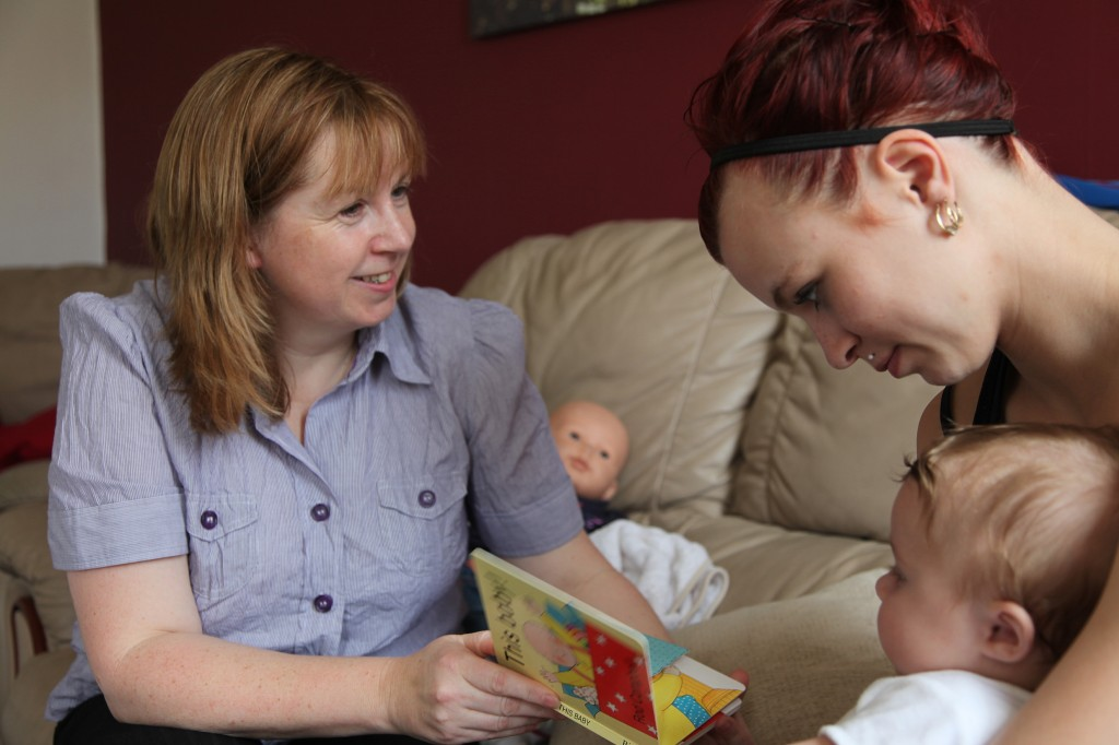 Family nurse talking to mother with child