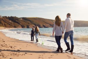 Family on holiday on a UK beach