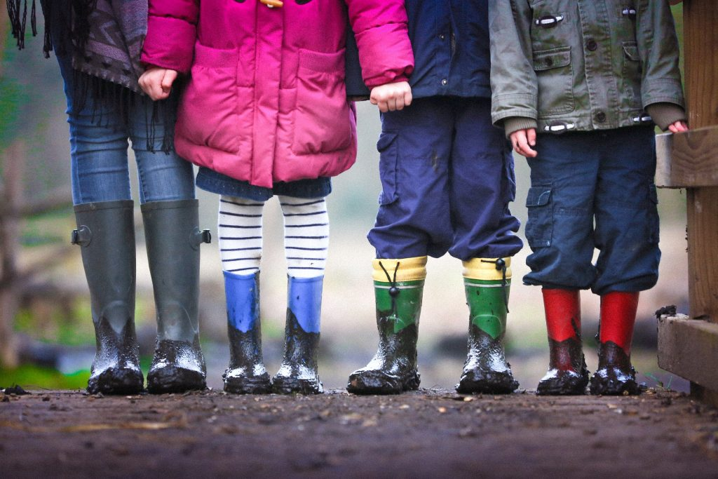 Group of small children standing together in winter clothes