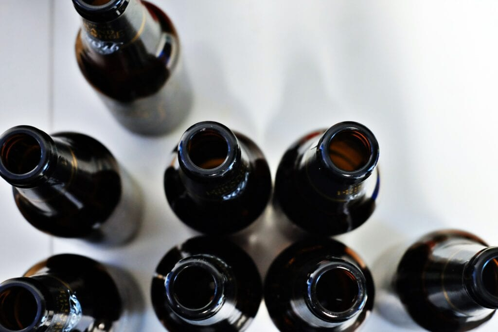 several empty black bottles photographed from above